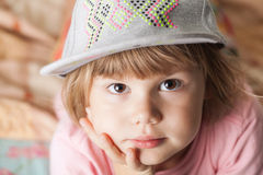 Portrait of thinking cute Caucasian blond baby girl Royalty Free Stock Image