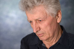 Portrait of an thinking elderly man Stock Photography