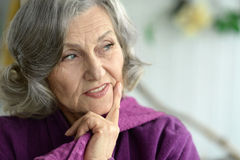 Portrait of thinking elderly woman. Close up Royalty Free Stock Photography