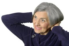Portrait of a thinking elderly woman Royalty Free Stock Photos