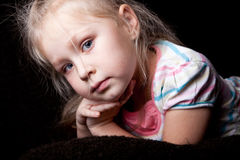 Portrait of the thinking girl child. Cute portrait of the thinking girl child Royalty Free Stock Photos