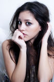 Portrait of a thinking girl. Portrait of hispanic girl thinking on white Royalty Free Stock Photos
