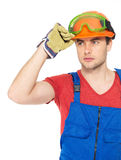 Portrait of thinking handyman in uniform Stock Photography