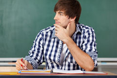 Portrait Of Thinking Male Teacher Royalty Free Stock Images