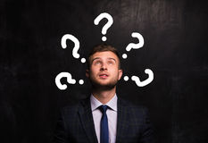 Portrait of thinking man on the background of the chalk board royalty free stock images