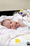 Portrait of thinking newborn baby Stock Photo
