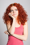 Portrait thinking red haired girl Stock Image