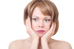 Portrait of thinking and sad woman. On white background Royalty Free Stock Photos