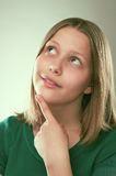 Portrait of a thinking teen girl royalty free stock photo