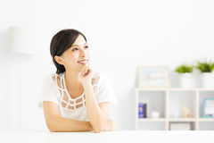 Portrait of  thinking woman looking up Royalty Free Stock Photography