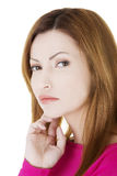 Portrait of a thinking woman Royalty Free Stock Images