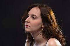 Portrait of thinking young brunette woman Royalty Free Stock Image