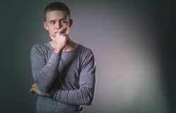 Portrait young man. Portrait of thinking young man in the studio Royalty Free Stock Image