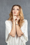 Portrait of thinking young woman with hand on chin Stock Photography