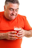 Portrait of a thirsty fat man staring at a glass of beer Royalty Free Stock Photos