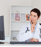 Portrait of a thoughful female doctor Royalty Free Stock Photo