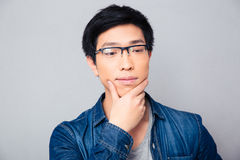 Portrait of a thoughtful asian man Royalty Free Stock Photos