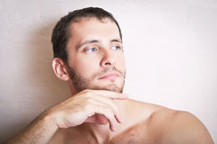 Portrait of thoughtful attractive man close up Royalty Free Stock Photo