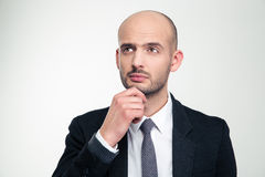 Portrait of thoughtful attractive young business man in black suit Royalty Free Stock Image