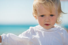Portrait of thoughtful baby on beach Royalty Free Stock Photos