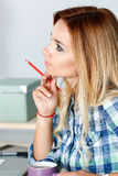 Portrait of thoughtful beautiful female designer holding pencil Royalty Free Stock Photo