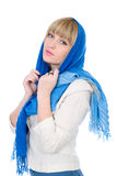 Portrait of thoughtful beautiful girl with a scarf. On white background Royalty Free Stock Photography