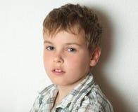 Portrait of thoughtful blonde boy Stock Image