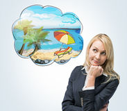 A portrait of a thoughtful blonde woman who dreams about summer vacation on the beach. A nice summer place is drawn in the thought Royalty Free Stock Images