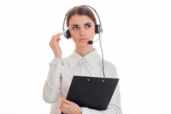 Portrait of thoughtful brunette call center worker girl with headphones and microphone isolated on white background Stock Photography
