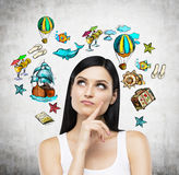 A portrait of thoughtful brunette who is surrounded by summer vacation icons which are drawn. A portrait of thoughtful brunette who is surrounded by summer Royalty Free Stock Photography