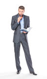 Portrait of thoughtful business man with diary Royalty Free Stock Photos