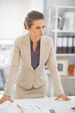 Portrait of thoughtful business woman in office Royalty Free Stock Photography