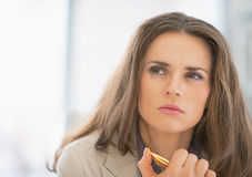 Portrait of thoughtful business woman with pen Royalty Free Stock Photo