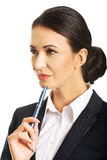 Portrait of thoughtful businesswoman holding a pen Royalty Free Stock Images