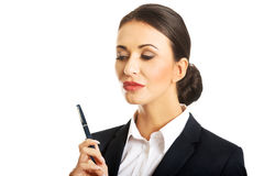 Portrait of thoughtful businesswoman holding a pen Stock Photography