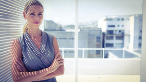 Portrait of a thoughtful businesswoman standing Royalty Free Stock Image