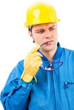 Portrait of a thoughtful construction worker with helmet Stock Images