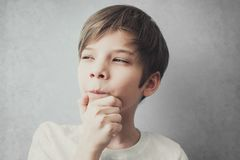 Portrait of thoughtful and cunning boy. Emotion concept Royalty Free Stock Photography
