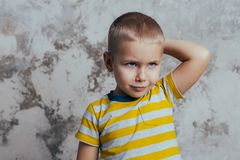 Portrait of a thoughtful cute little child with hand touching face stock images