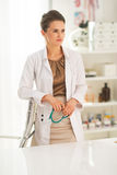 Portrait of thoughtful doctor woman in office Royalty Free Stock Images
