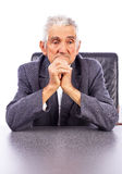 Portrait of a thoughtful elderly man holding his hands together. Under his chin  on white background Royalty Free Stock Photo