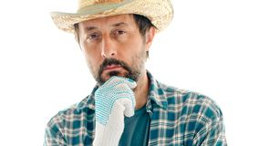Portrait of thoughtful farmer on white background royalty free stock photo