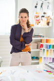 Portrait of thoughtful fashion designer in office. Portrait of thoughtful fashion designer in modern office stock photo
