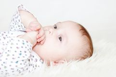 Portrait of the thoughtful five-months baby Stock Photography