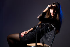 Portrait of the thoughtful girl sitting on a chair Stock Images
