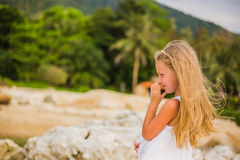 Portrait of thoughtful girl on a summer day in the tropics Stock Photos
