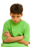 Portrait of a thoughtful kid. A portrait of a stubborn boy; isolated on the white background Stock Image