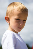 Portrait of thoughtful little boy child outdoor Stock Photo