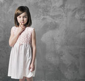 Portrait of a thoughtful little girl Royalty Free Stock Photo
