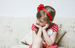 Portrait of a thoughtful little girl Stock Images